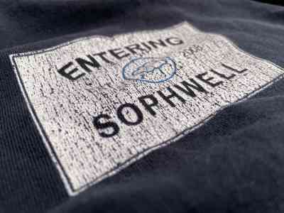 Photo of an old Sophwell t-shirt worn down over time. Print, apparel and promotional products